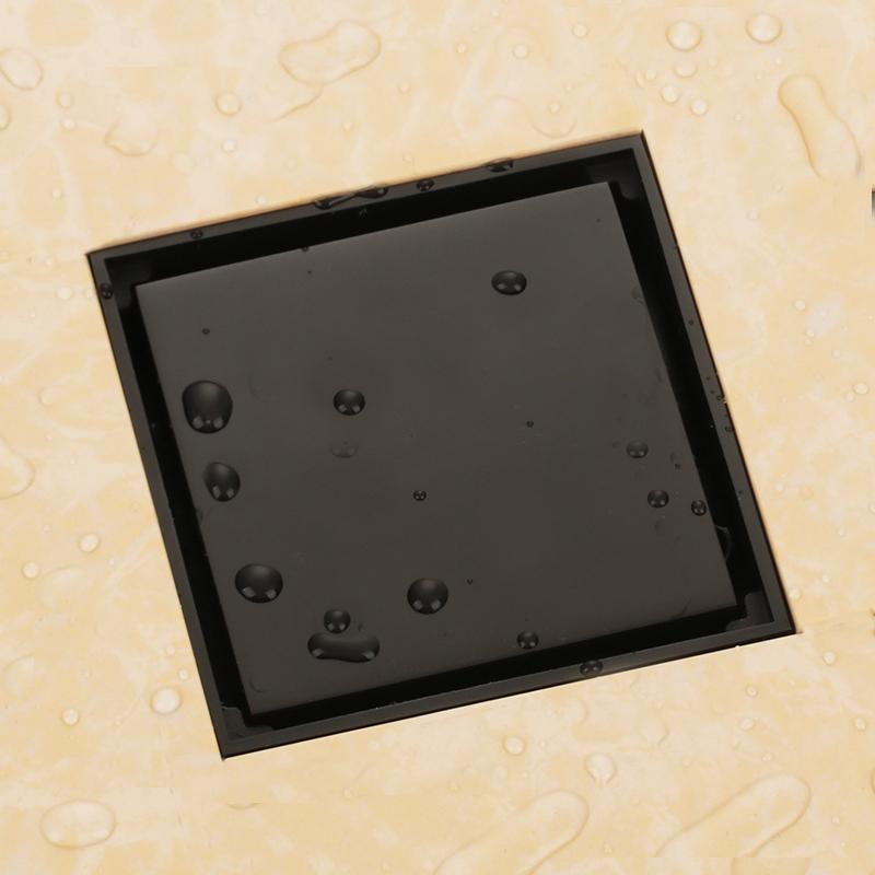 https://www.junoshowers.com/media/catalog/product/b/l/blackened_solid_brass_4_x_4_square_bathroom_drain.jpg